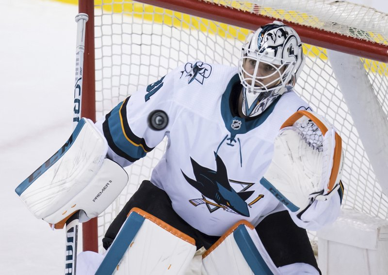 San Jose Sharks goalie Martin Jones catches the puck during the second period of an NHL hockey game against the Vancouver Canucks in Vancouver, British Columbia, on Monday, Feb. (Darryl Dyck/The Canadian Press via AP)
