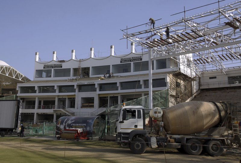 In this Feb. 9, 2019 photo, a renovation of National Stadium is in progress for the upcoming Pakistan Super League in Karachi, Pakistan. (AP Photo/Fareed Khan)