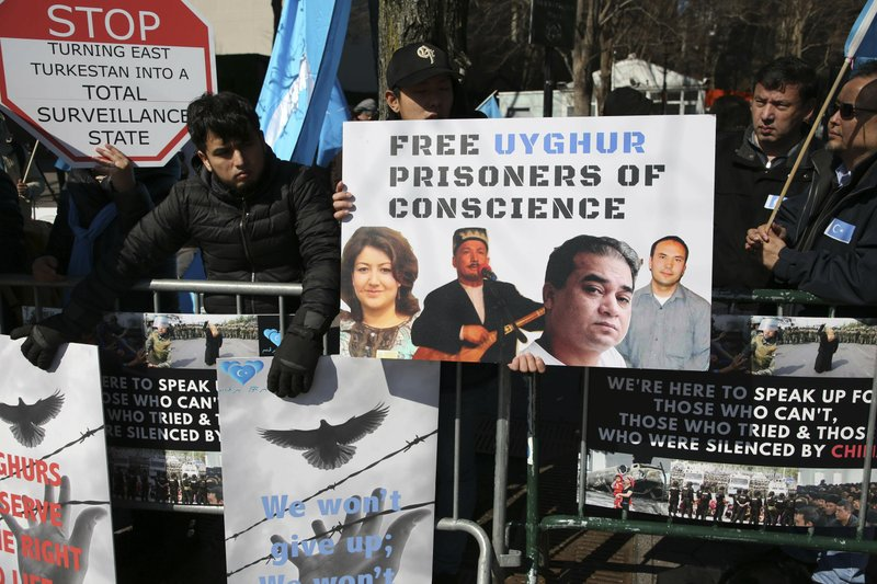 FILE - In this March 15, 2018, file photo, Uighurs and their supporters rally across the street from United Nations headquarters in New York. (AP Photo/Seth Wenig, File)