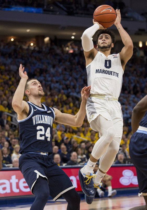 File-This Feb. 9, 2019, file photo shows Marquette guard Markus Howard, right, going up for a basket against Villanova guard Joe Cremo, left, during the first half of an NCAA college basketball game in Milwaukee. (AP Photo/Darren Hauck, File)