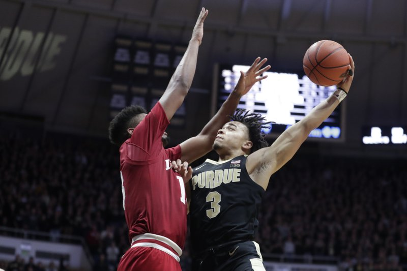 File-This Jan. 19, 2019, file photo shows Purdue guard Carsen Edwards (3) shooting over Indiana forward Juwan Morgan (13) during the second half of an NCAA college basketball game in West Lafayette, Ind. (AP Photo/Michael Conroy, File)