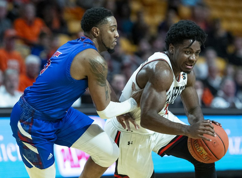 Campbell University guard Chris Clemons, right, drives to the basket while being covered by Presbyterian College guard Davon Bell in the first half of an NCAA basketball game Thursday, Jan. (AP Photo/Jason E. Miczek)