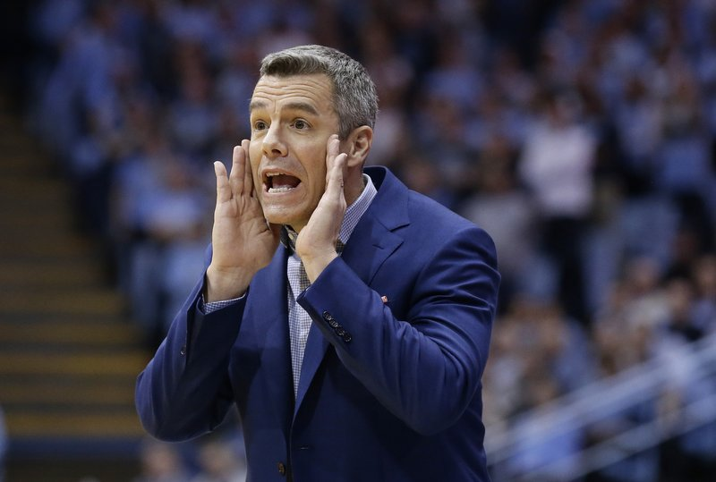 Virginia head coach Tony Bennett directs his players during the first half of an NCAA college basketball game against North Carolina in Chapel Hill, N. (AP Photo/Gerry Broome)