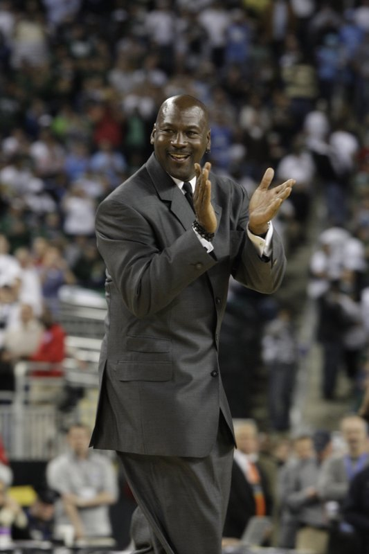 File-This April 6, 2009, file photo shows former North Carolina and NBA player Michael Jordan at halftime of the championship game at the men's NCAA Final Four college basketball tournament. (AP Photo/Paul Sancya, File)