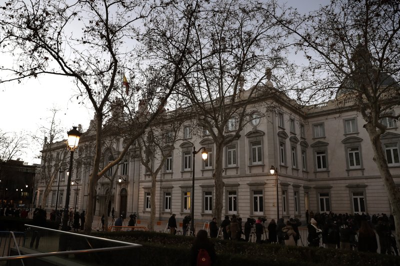 Journalists wait outside the Spanish Supreme Court in Madrid, Tuesday, Feb. 12, 2019. Spain is bracing for the nation's most sensitive trial in four decades of democracy this week, with a dozen Catalan separatists facing charges including rebellion over a failed secession bid in 2017. (AP Photo/Manu Fernandez)