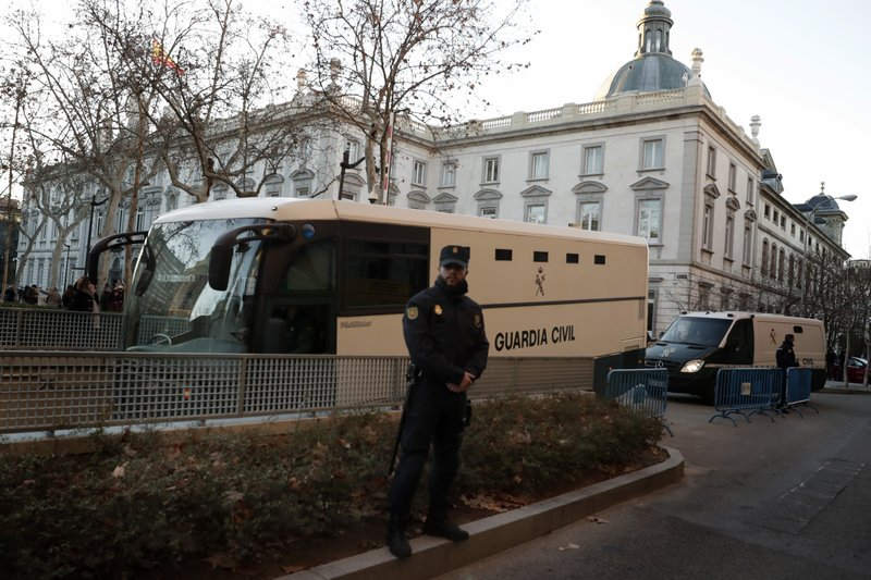 A bus belonging to Spain's Civil Guard allegedly carrying Catalonian politicians and activists, arrives at the Spanish Supreme Court in Madrid, Tuesday, Feb. (AP Photo/Manu Fernandez)