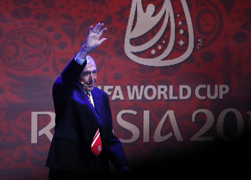 FILE - In this Friday Dec. 1, 2017 file photo former English soccer international Gordon Banks waves as he walks on stage for the 2018 soccer World Cup draw in the Kremlin in Moscow. (AP Photo/Pavel Golovkin, File)