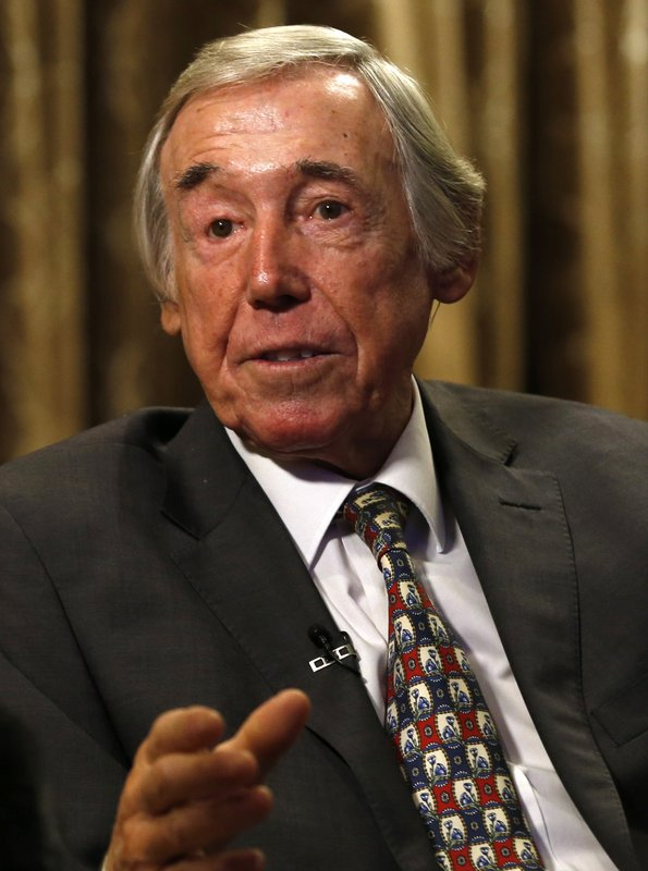 FILE - In this Tuesday, Jan. 5, 2016 file photo former England goalkeeper Gordon Banks talks to the media at the Royal garden Hotel in London. (AP Photo/Alastair Grant, File)