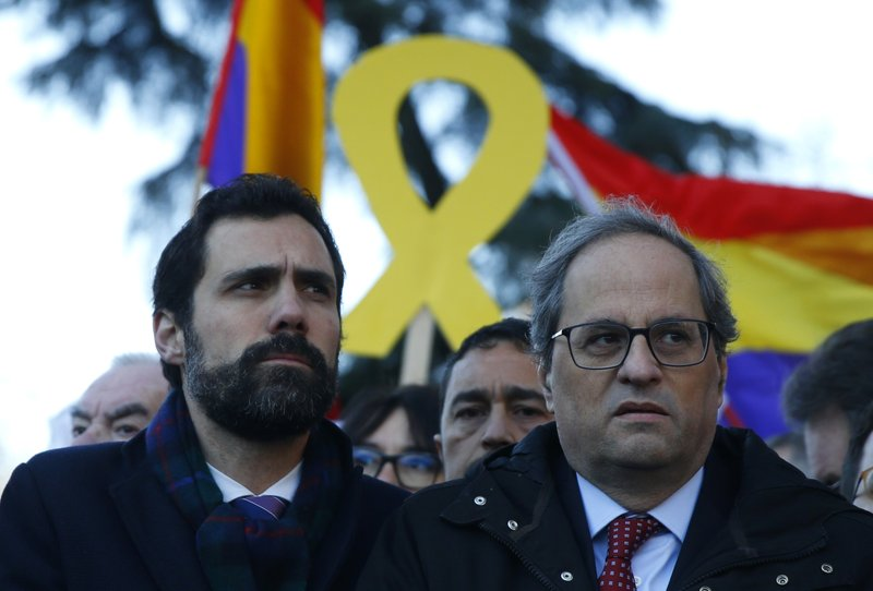 Catalan regional President Quim Torra, right, and the president of Catalonian Parliament Roger Torrent arrive at the Spanish Supreme Court in Madrid, Tuesday, Feb. (AP Photo/Andrea Comas)