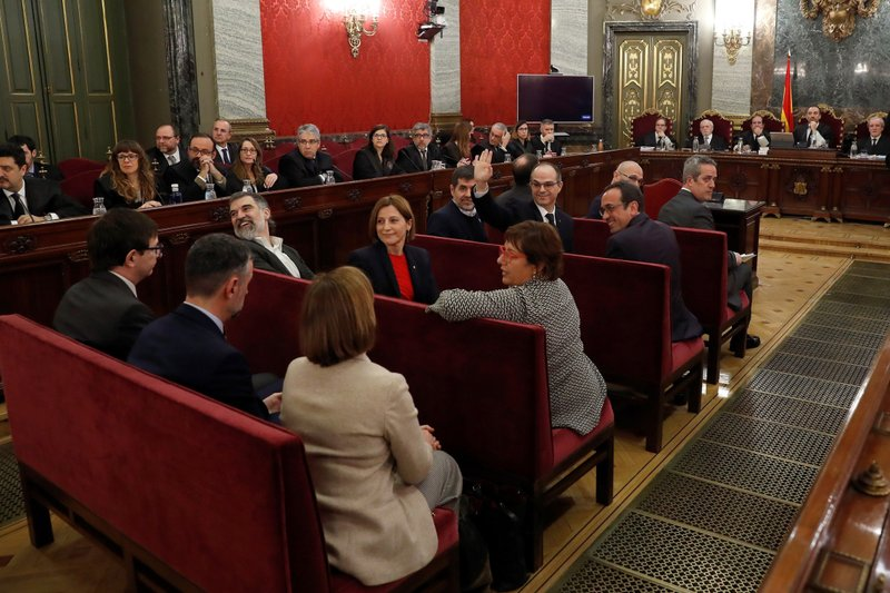 Twelve separatist leaders sit on the bench during the trial at the Spanish Supreme Court in Madrid, Tuesday, Feb. (AP Photo/J.J. Guillen, Pool)