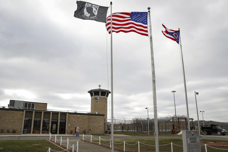 In this Wednesday, Jan. 9, 2019, photo, fences line the exterior of the Southern Ohio Correctional Facility, in Lucasville, Ohio. (AP Photo/John Minchillo)