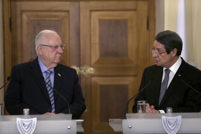 Cyprus' President Nicos Anastasiades, right, and Israel's President Reuven Rivlin talk to the media during a press conference after their meeting at the presidential palace in divided capital Nicosia, Cyprus, Tuesday, Feb. (AP Photo/Petros Karadjias)
