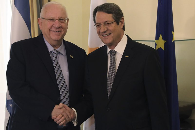 Cyprus' president Nicos Anastasiades, right, and Israel's President Reuven Rivlin shake hands during their meeting at the presidential palace in divided capital Nicosia, Cyprus, on Tuesday, Feb. (Yiannis Kourtoglou/Pool via AP)