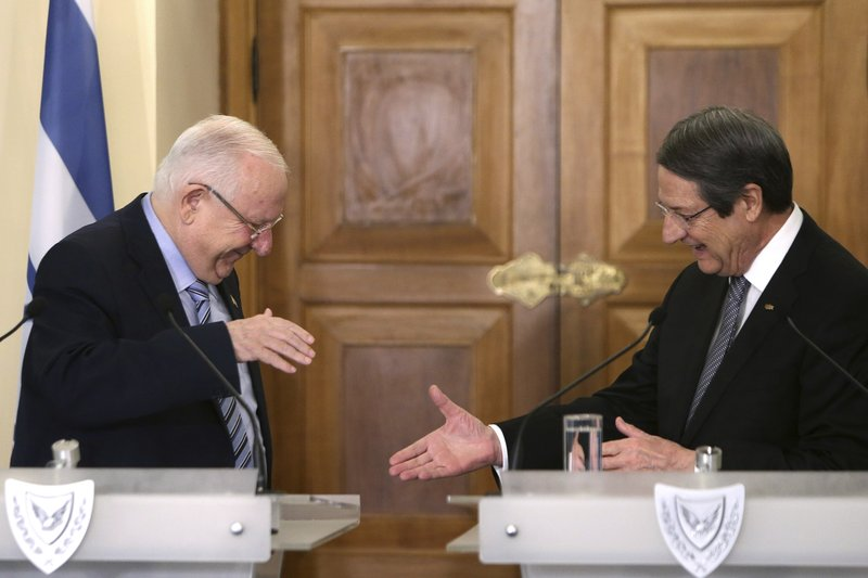 Cyprus' president Nicos Anastasiades, right, shakes hands with Israel's President Reuven Rivlin after their meeting at the presidential palace in divided capital Nicosia, Cyprus, on Tuesday, Feb. (AP Photo/Petros Karadjias)