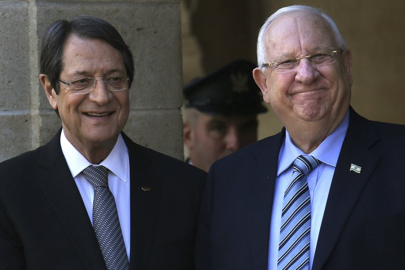 Cyprus' president Nicos Anastasiades, left, and Israel's President Reuven Rivlin smile at the presidential palace in divided capital Nicosia, Cyprus, on Tuesday, Feb. (AP Photo/Petros Karadjias)
