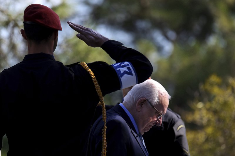Israel's President Reuven Rivlin reviews a military guard of honor during a welcoming ceremony before a meeting with Cyprus' president Nicos Anastasiades at the presidential palace in divided capital Nicosia, Cyprus, on Tuesday, Feb. (AP Photo/Petros Karadjias)