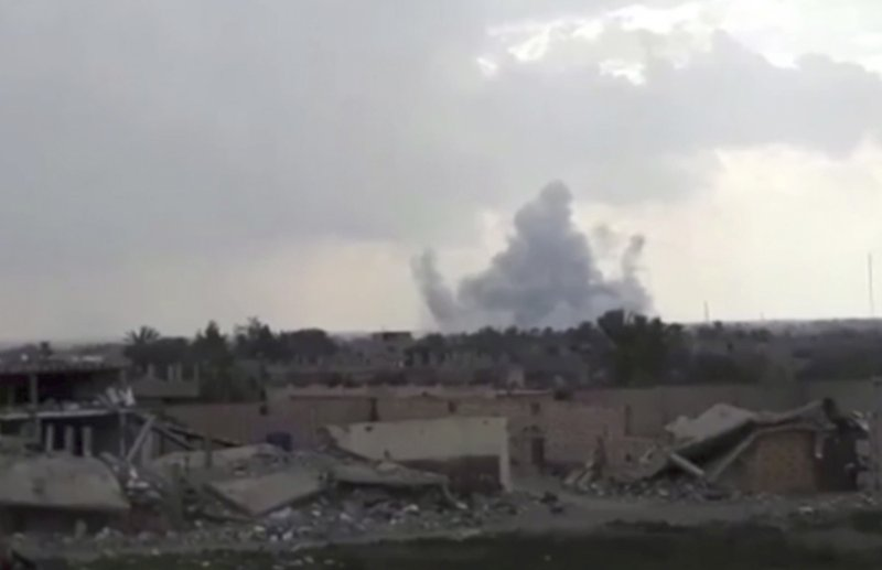 This frame grab from video provided on Tuesday, Feb. 12, 2019, by the Syrian Observatory for Human Rights, an opposition group, that is consistent with independent AP reporting, shows smoke rising from a shell that targeted Islamic State group militants, in the village of Baghouz, Deir El-Zour, eastern Syria. (Syrian Observatory for Human Rights via AP)