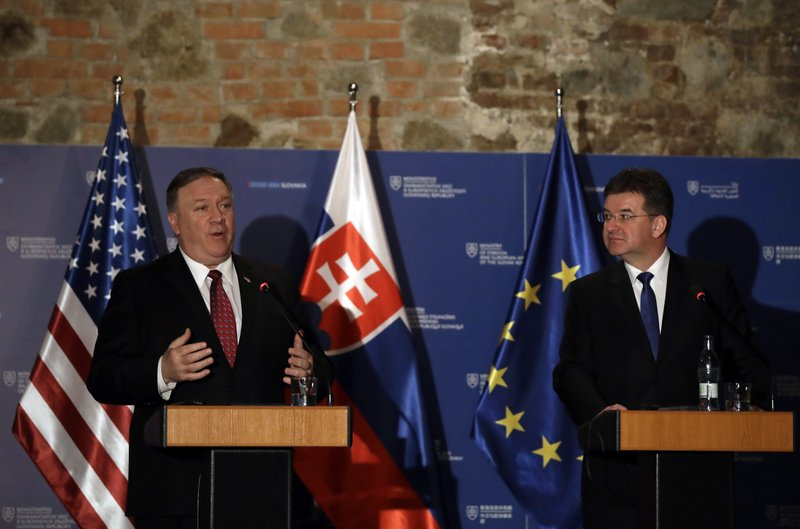 Slovakia Foreign Affairs Minister Miroslav Lajcak, right, and US Secretary of State Mike Pompeo address the media during a press conference in Bratislava, Slovakia, Tuesday, Feb. (AP Photo/Petr David Josek)