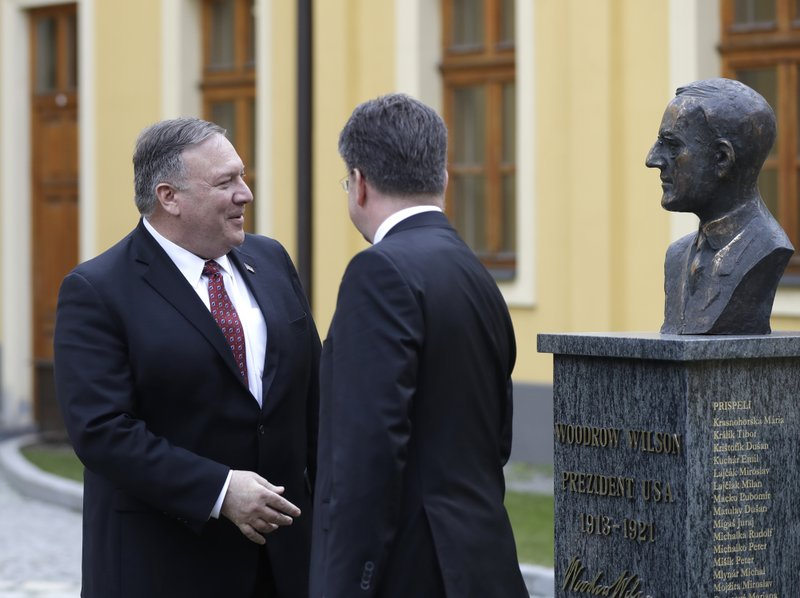 Slovakia Foreign Affairs Minister Miroslav Lajcak, right, welcomes US Secretary of State Mike Pompeo during his visit to Bratislava, Slovakia, Tuesday, Feb. (AP Photo/Petr David Josek)