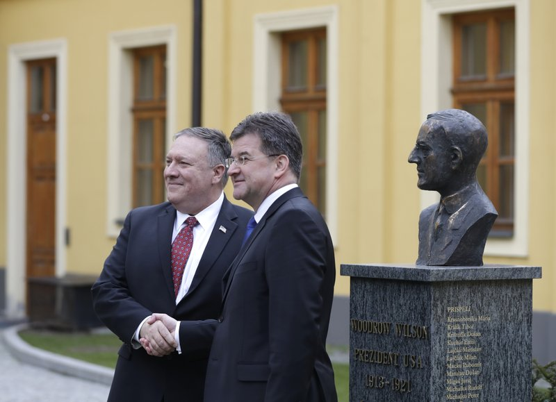 Slovakia Foreign Affairs Minister Miroslav Lajcak, right, welcomes US Secretary of State Mike Pompeo, during his visit to Bratislava, Slovakia, Tuesday, Feb. (AP Photo/Petr David Josek)