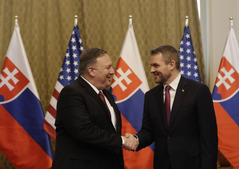 Slovakia's Prime Minister Peter Pellegrini, right, welcomes US Secretary of State Mike Pompeo during his visit to Bratislava, Slovakia, Tuesday, Feb. (AP Photo/Petr David Josek)