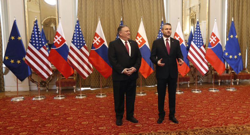 Slovakia's Prime Minister Peter Pellegrini, right, welcomes US Secretary of State Mike Pompeo, during his visit to Bratislava, Slovakia, Tuesday, Feb. (AP Photo/Petr David Josek)