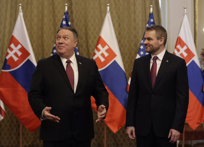 Slovakia's Prime Minister Peter Pellegrini, right, welcomes US Secretary of State Mike Pompeo, left, during his visit to Bratislava, Slovakia, Tuesday, Feb. (AP Photo/Petr David Josek)