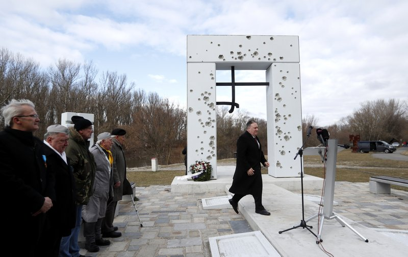 US Secretary of State Mike Pompeo arrives at the Freedom Gate memorial in Bratislava, Slovakia, Tuesday, Feb. (AP Photo/Petr David Josek)
