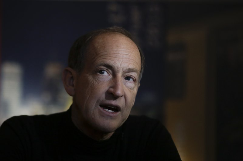 Director Charles Ferguson speaks to the Associated Press about his movie 'Watergate' during an interview at the 2019 Berlinale Film Festival in Berlin, Germany, Tuesday, Feb. (AP Photo/Markus Schreiber)
