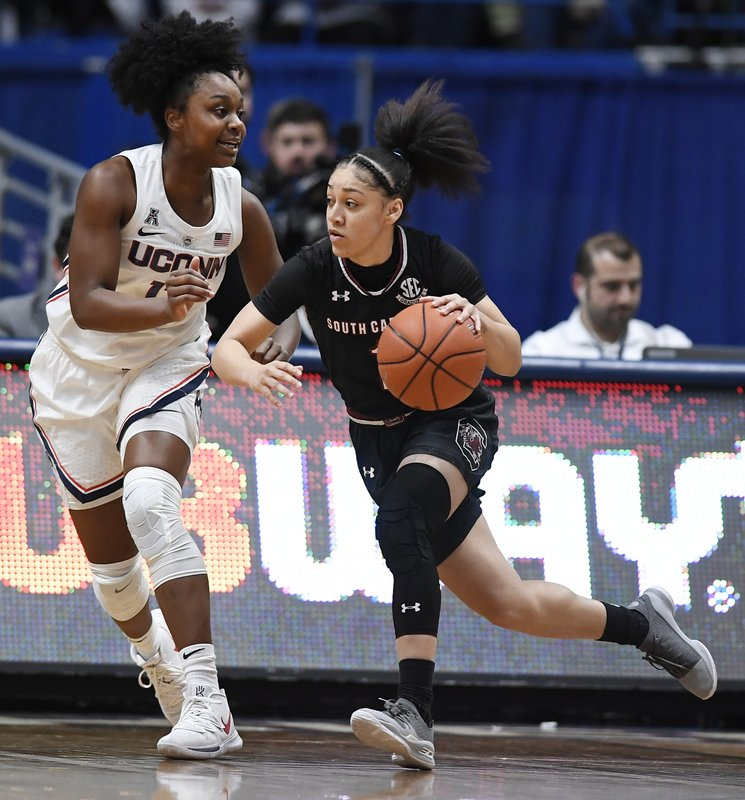 South Carolina's Bianca Cuevas-Moore, right, dribbles as Connecticut's Christyn Williams defends, during the first half of an NCAA college basketball game, Monday, Feb. (AP Photo/Jessica Hill)