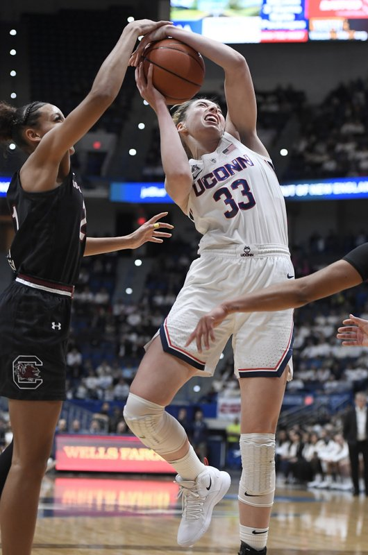 Connecticut's Katie Lou Samuelson, right, is fouled by South Carolina's Mikiah Herbert Harrigan, left, during the first half of an NCAA college basketball game, Monday, Feb. (AP Photo/Jessica Hill)