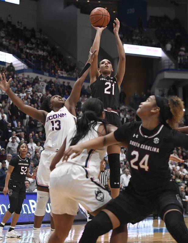 South Carolina's Mikiah Herbert Harrigan (21) makes a basket as Connecticut's Christyn Williams (13) defends during the first half of an NCAA college basketball game, Monday, Feb. (AP Photo/Jessica Hill)
