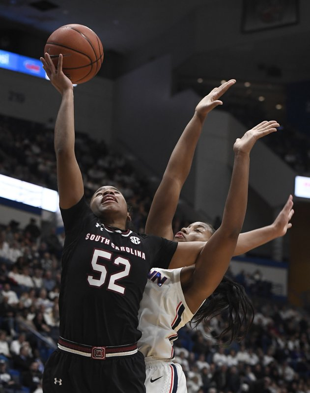 South Carolina's Tyasha Harris (52) goes up for a basket as Connecticut's Megan Walker (3) defends during the first half of an NCAA college basketball game, Monday, Feb. (AP Photo/Jessica Hill)