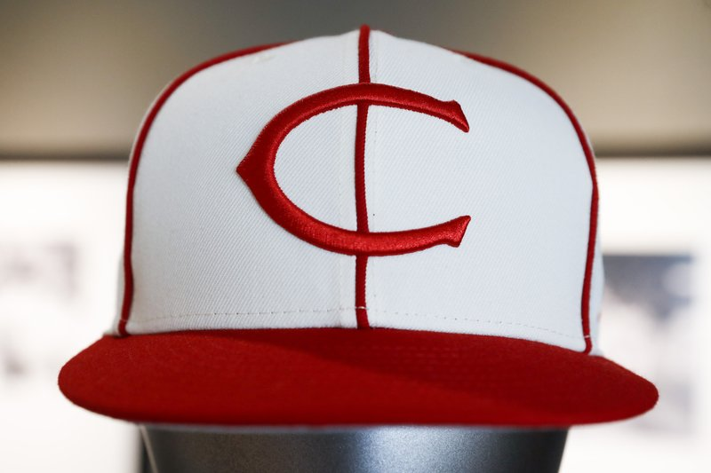 The Cincinnati Reds baseball team uniforms for the 2019 season are displayed at Great American Ball Park, Monday, Jan. (AP Photo/John Minchillo)
