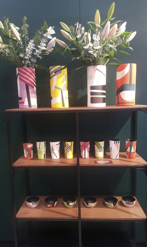 This Feb. 3, 2019 photo shows items by Sally Blair of Lubbock, Texas at the NY NOW show in New York. Her eye catching collection of hand painted vessels are inspired by the Bauhaus school of modernism. (Kim Cook via AP)
