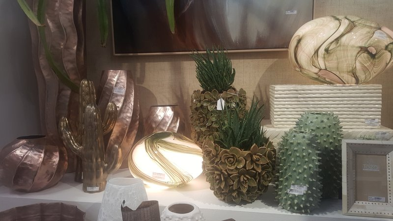 This Feb. 3, 2019 photo shows pieces showcased at the NY NOW show in New York. Nature was a strong theme in accessories, with flora and fauna depicted in metals, ceramics and woods. (Kim Cook via AP)