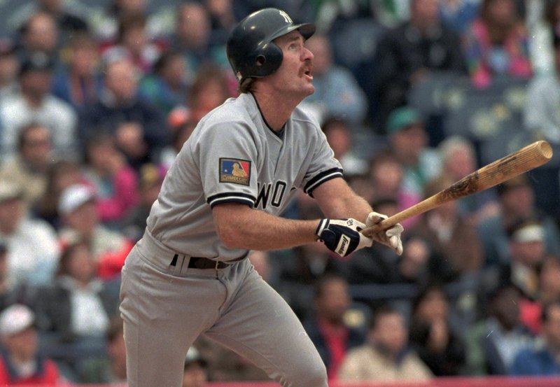 FILE - In this May 14, 1994, file photo, New York Yankees' wears Major League Baseball's 100th anniversary patch as he follows the flight of his ninth inning two-RBI double against the Milwaukee Brewers, in Milwaukee. (AP Photo/Roberto Borea, File)