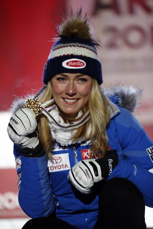 United States' Mikaela Shiffrin poses with her gold medal of the women's super-G, at the alpine ski World Championships in Are, Sweden, Tuesday, Feb. (AP Photo/Gabriele Facciotti)