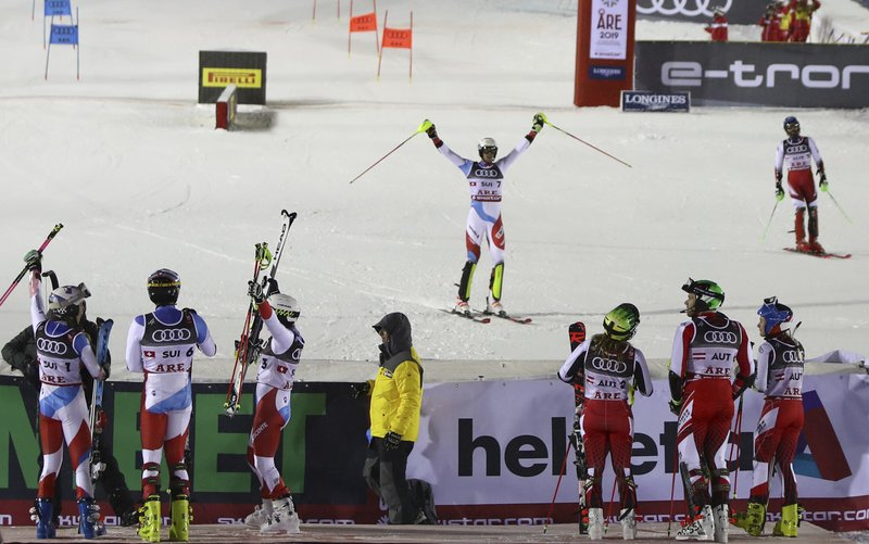 Switzerland's Ramon Zenhaeusern, center, celebrates as Switzerland wins the team event, at the alpine ski World Championships in Are, Sweden, Tuesday, Feb. (AP Photo/Alessandro Trovati)