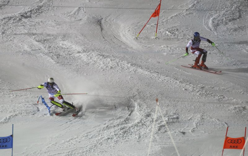 Switzerland's Ramon Zenhaeusern, left, beats Austria's Marco Schwarz in the final race of the team event, at the alpine ski World Championships in Are, Sweden, Tuesday, Feb. (AP Photo/Marco Trovati)