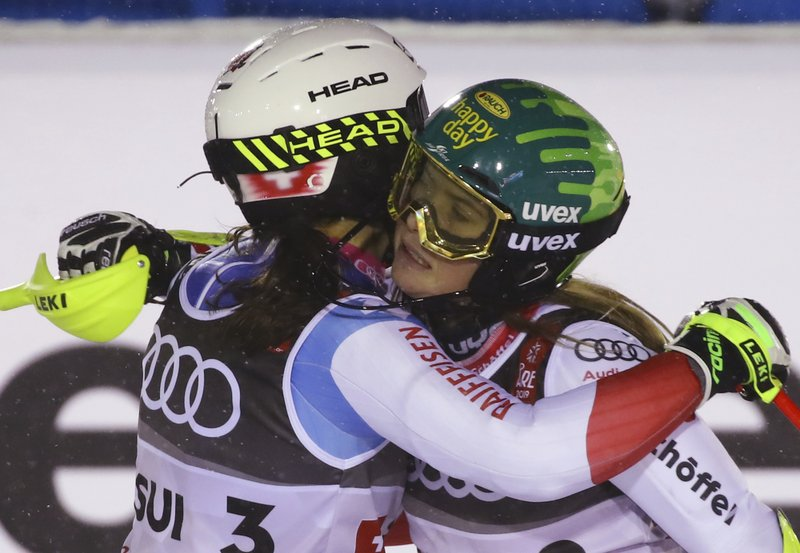 Switzerland's Wendy Holdener, left, and Austria's Katharina Liensberger embrace in the finish area during the team event, at the alpine ski World Championships in Are, Sweden, Tuesday, Feb. (AP Photo/Marco Trovati)