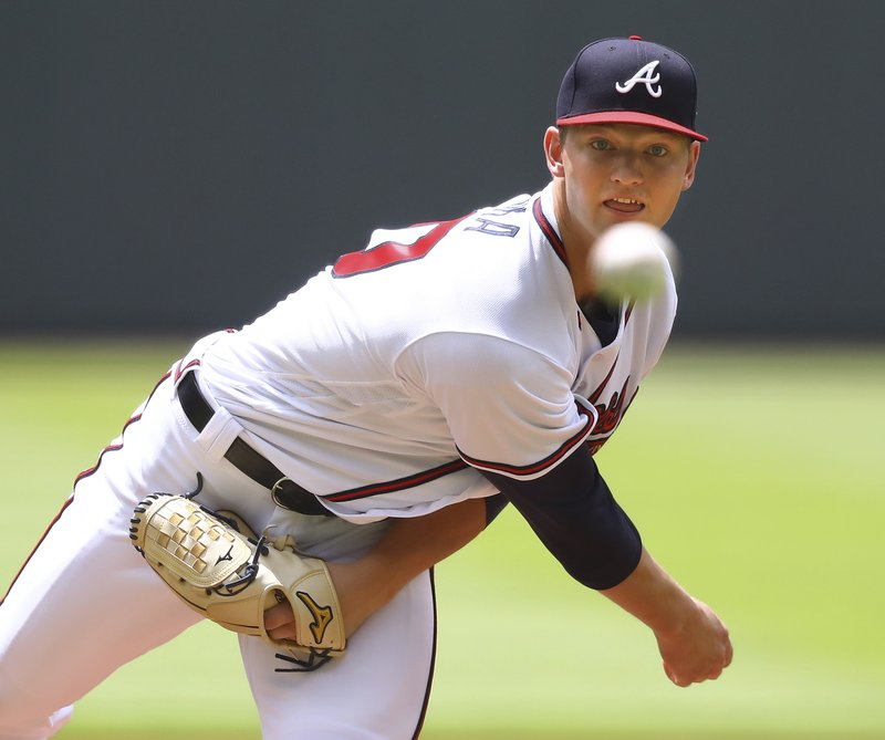 FILUE - In this June 13, 2018, file photo, Atlanta Braves pitcher Mike Soroka throws against the New York Mets, during the first inning of a baseball game, in Atlanta. (Curtis Compton/Atlanta Journal-Constitution via AP)/Atlanta Journal-Constitution via AP)