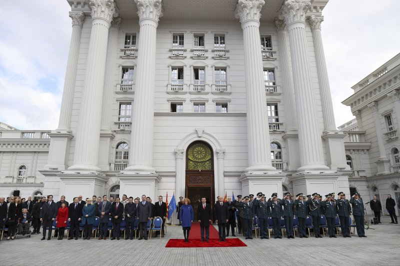 Macedonian officials take part at a ceremony in front of the government building in Skopje, Tuesday, Feb. (AP Photo/Dragan Perkovksi)