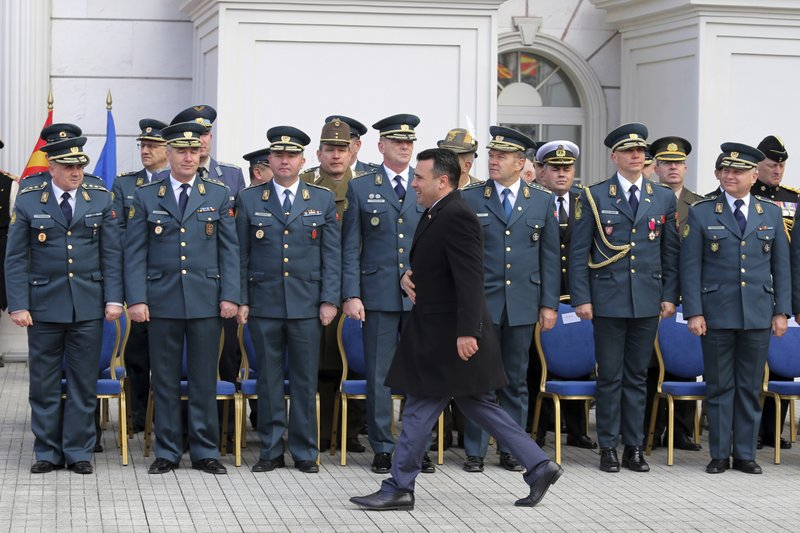Macedonian Prime Minister Zoran Zaev passes in front of army officers during a ceremony at the government building in Skopje, Tuesday, Feb. (AP Photo/Dragan Perkovksi)