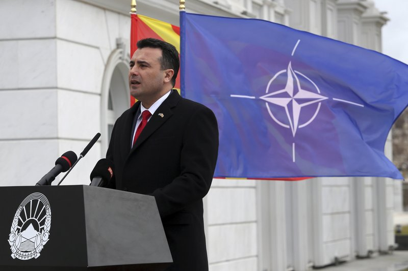 Macedonian Prime Minister Zoran Zaev delivers a speech in front of the NATO flag during a ceremony at the government building in Skopje, Tuesday, Feb. (AP Photo/Dragan Perkovksi)