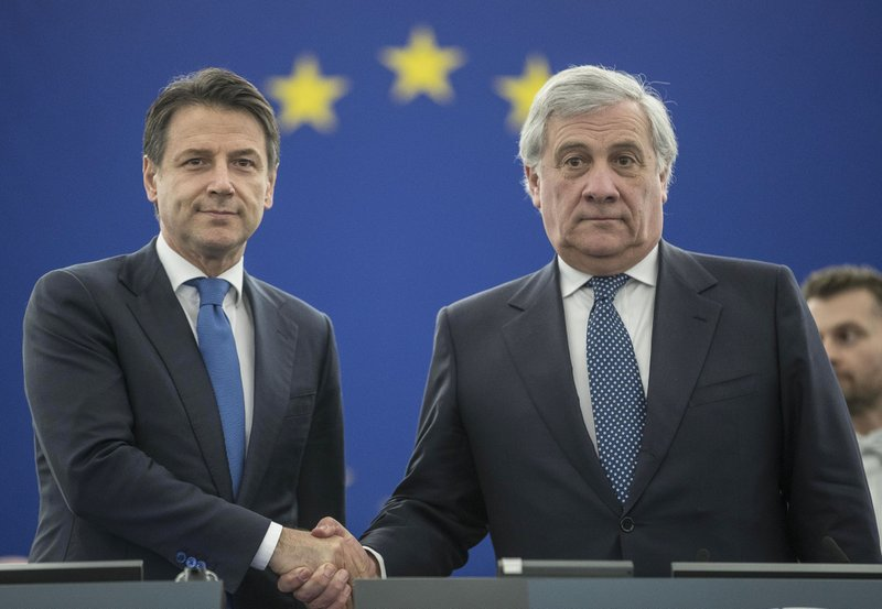 Italian Prime Minister Giuseppe Conte, left, shakes hands with European Parliament President Antonio Tajani prior to a debate on the future Europe at the European Parliament in Strasbourg, eastern France, Tuesday Feb. (AP Photo/Jean-Francois Badias)