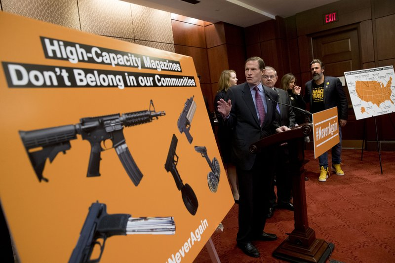 Sen. Richard Blumenthal, D-Conn., center, accompanied by Sen. Bob Menendez, D-N.J., third from right, speaks at a news conference on an proposed amendment to ban high capacity magazines in guns, on Capitol Hill, Tuesday, Feb. (AP Photo/Andrew Harnik)