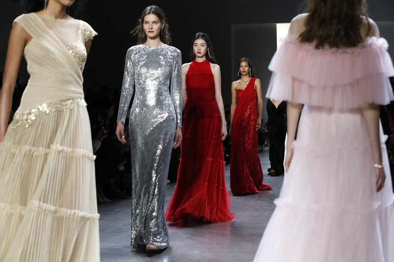 The latest fashion creations from Tadashi Shoji are modeled during New York Fashion Week, Thursday Feb. (AP Photo/Kathy Willens)