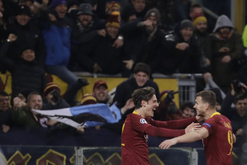 Roma midfielder Nicolo' Zaniolo, left, celebrates after scoring his side's second goal with his teammate Edin Dzeko during a Champions League round of 16 first leg soccer match between Roma and Porto, at Rome's Olympic Stadium, Tuesday, Feb. (AP Photo/Andrew Medichini)