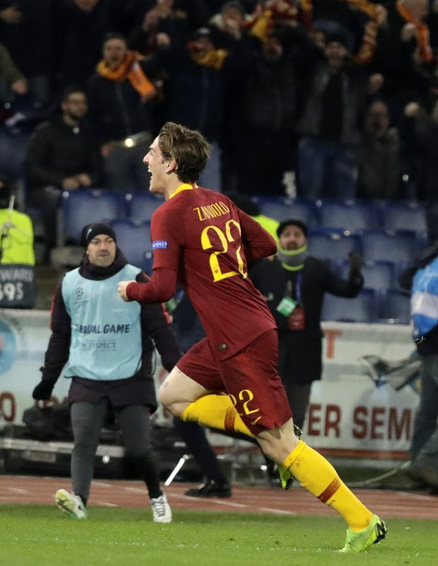 Roma midfielder Nicolo' Zaniolo celebrates after scoring the opening goal of his team during a Champions League round of 16 first leg soccer match between Roma and Porto, at Rome's Olympic Stadium, Tuesday, Feb. (AP Photo/Andrew Medichini)